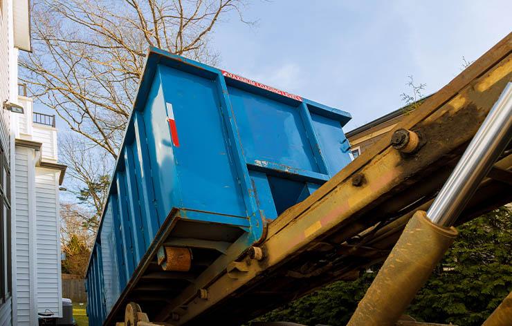 roll off dumpster being delivered